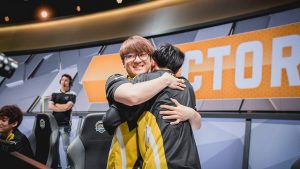 "Picture of Team Dignitas's Johnny ""Altec"" Ru hugs teammate Adrian ""Adrian"" Ma"